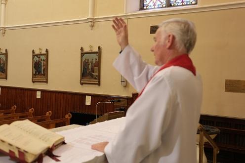 Fr. Mangan blessing his Parishioners on Good Friday